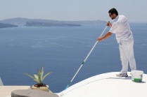 Oia Rooftop Painter